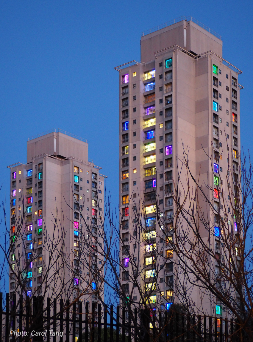 The Redfern Waterloo Towers lit up with coloured lights