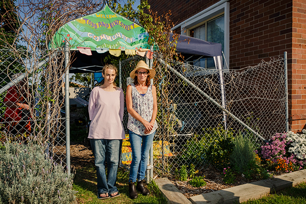 Natasha and Sharyn standing outside the community garden
