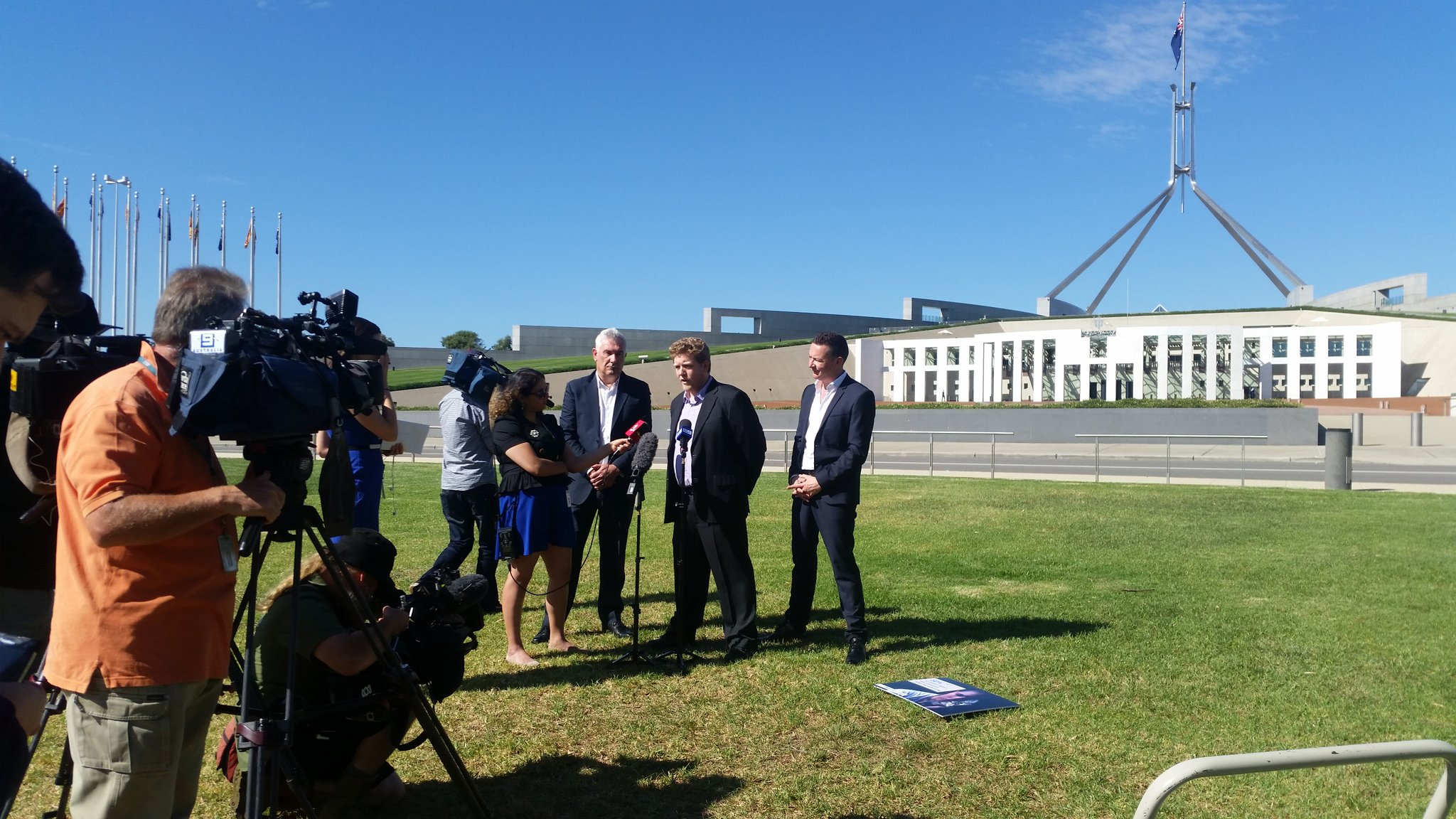 Ned Cutcher speaking to media outside Australian parliament house