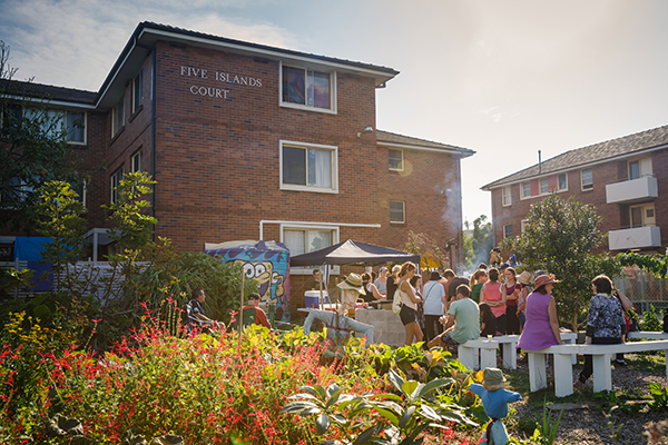 Residents and guests in the community garden